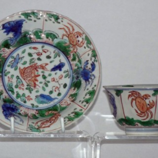 KANGXI FAMILLE VERTE MOULDED TEA BOWL AND SAUCER