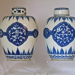 KANGXI BLUE AND WHITE PAIR OF PORCELAIN LIDDED JARS