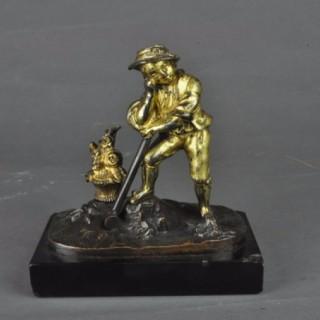 Gilt bronze figure of a farm boy