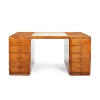A George V Art Deco figured walnut kneehole desk