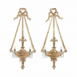 A pair of 19th century gilt wood three-light wall appliques.