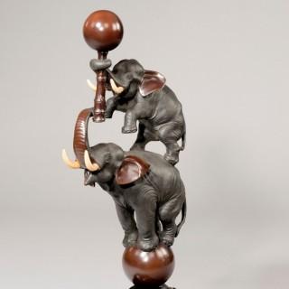 Meiji period bronze elephants set in its original hardwood stand