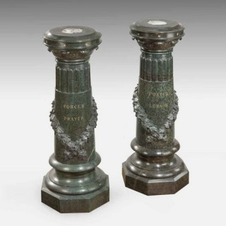 An unusual pair of Victorian marble revolving topped pedestals