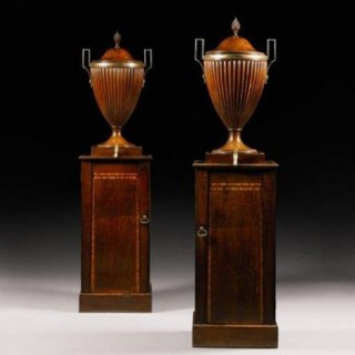 A fine pair of George III mahogany wine cisterns attributed to Gillows