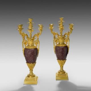 A pair of Empire royal porphyry and ormolu candelabra.