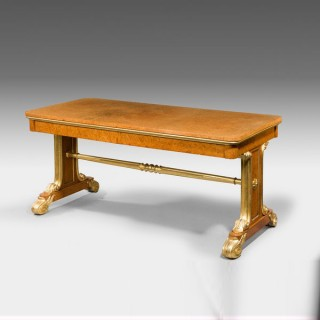 Regency Amboyna and parcel gilt end support library table