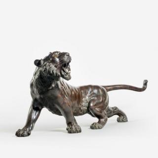 A prowling bronze tiger by Genryusai Seiya