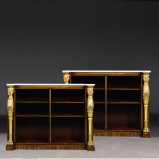 A pair of Regency rosewood and parcel gilt bookcases