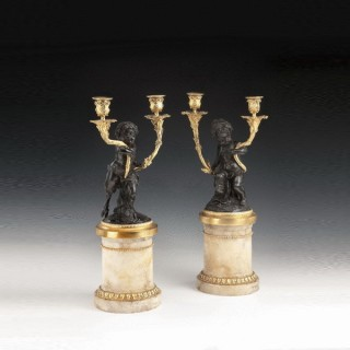 A pair of antique French bronze and gilt Candelabra