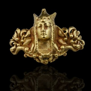 An unusual brooch designed as a bust of a valkyrie set between foliate terminals, Boucheron, c1890