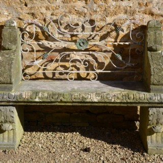An early 20th century carved limestone seat
