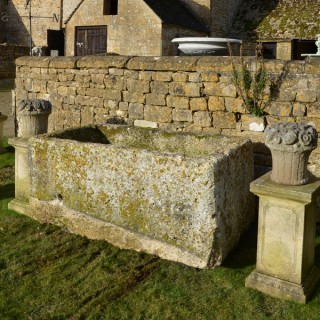 A large antique limestone trough