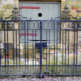 A pair of 19th century wrought iron parkland gates