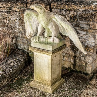 A pair of impressive carved stone eagles