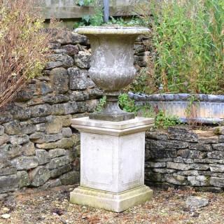 An Italian weathered white marble campana urn