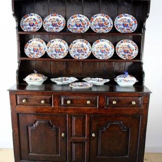 An 18th Century joined oak enclosed Welsh dresser