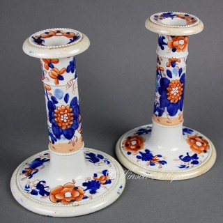 A pair of Mason's Ironstone China candle sticks