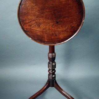 A Regency Elm tilt top table