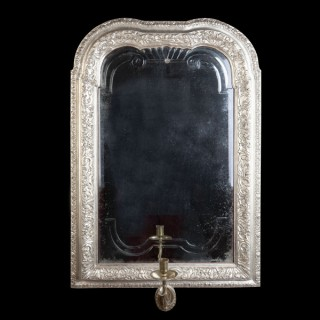 A QUEEN ANNE SILVERED MIRROR SCONCE