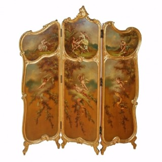 A Rococo style parcel gilt and painted three-fold screen