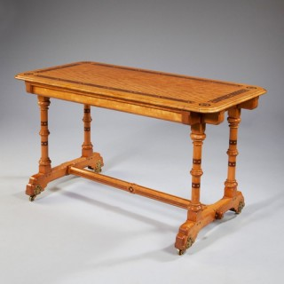 AN ARTS AND CRAFTS SATINWOOD WRITING TABLE BY MARSH AND JONES