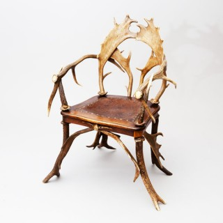A FINE BLACK FOREST ANTLER ARMCHAIR