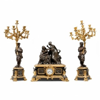 A fine marble mounted gilt and patinated bronze three piece clock set