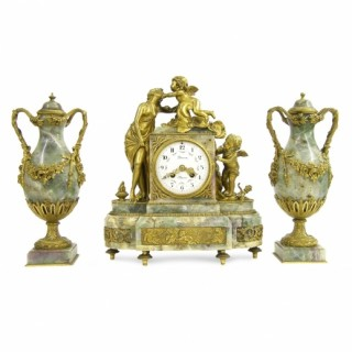 An ormolu mounted Fluorspar three piece clock set by Lerron