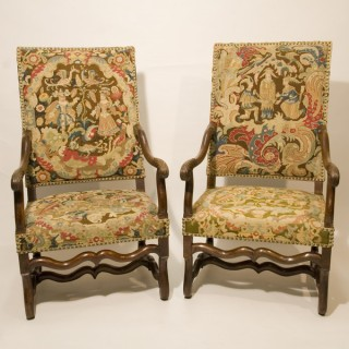 A Pair of Early 18th Century French Walnut Armchairs