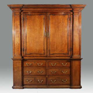 A George III Architectural Oak Press Cupboard