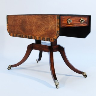 A Regency Mahogany and Calamander Crossbanded Pembroke Table