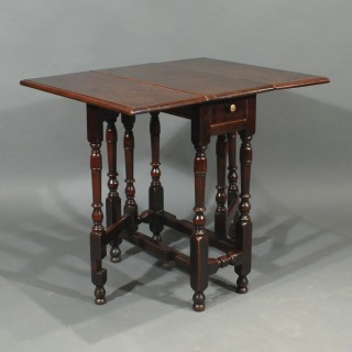 A William and Mary Period Walnut Gateleg Table
