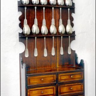 Attractive later 18th century oak spoon rack