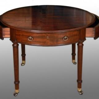 A late 18th century mahogany oval library table