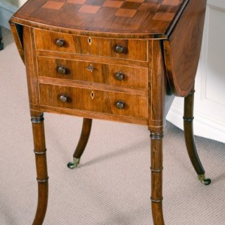 A fine Sheraton period rosewood Pembroke games table