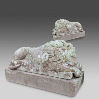 A RARE PAIR OF FINE SANDSTONE CARVED LIONS