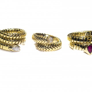 Three rings by Bvlgari in 18 carat gold and all part of their Tuba Gas range of the 1980-1990's