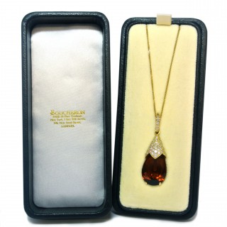 A signed Boucheron and diamond drop pendant