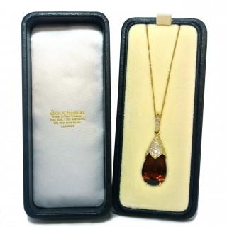 A signed Boucheron and diamond drop pendant