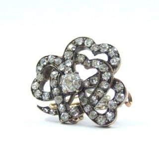 An exquisite Victorian interlocking diamond heart motif trefoil shamrock brooch pin