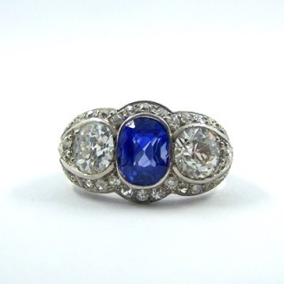 A superb sapphire and diamond three stone ring
