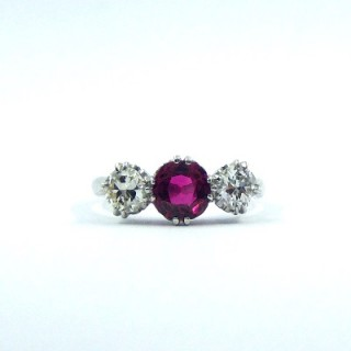 A stunning ruby & diamond three stone ring