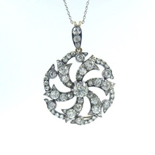 An imposing Victorian diamond 'Catherine Wheel' brooch pendant necklace