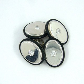 A pair of diamond and onyx chain link oval cufflinks
