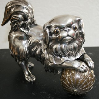 japanese silvered bronze sculpture of a japanese chin with a multimetal ball