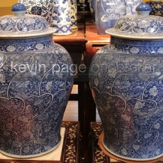 A pair of Chinese blue and white temple jars decorated with a close floral panel design, Kang Hsi period
