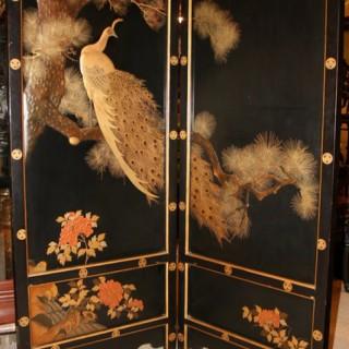 A Japanese lacquer screen of a golden peacock