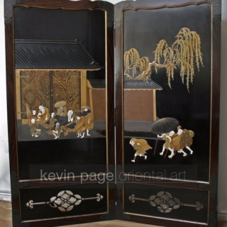 A Japanese lacquer screen decorated with figures sheltering from the rain