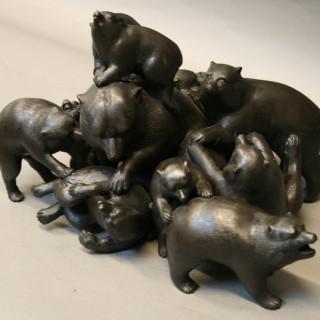 A bronze sculpture of a pile of bears