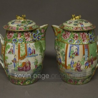 A pair of Chinese Cantonese jugs and lids